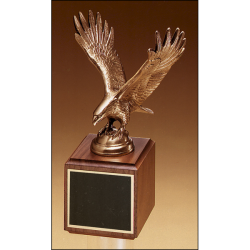Fully modeled antique bronze eagle casting on a walnut base.
