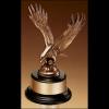 Fully modeled antique bronze eagle casting on a black wood base