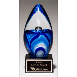 Art glass egg with blue and white accents on black glass base