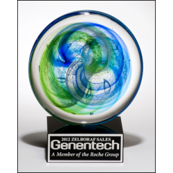 Art glass disk with blue and light green accents on black glass base with felt bottom
