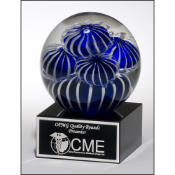 Art glass globe with blue and white sea anemone design on black glass base with felt bottom.