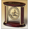 Skeleton clock with sub-second dial, brass finished movement and rosewood piano finish accents