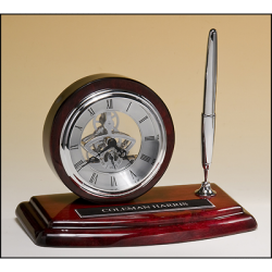 Skeleton clock, silver movement and pen with rosewood piano-finish case