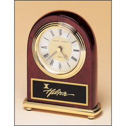 Rosewood stained piano finish Airflyte clock on a brass base