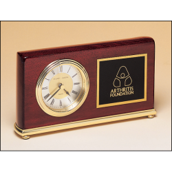 Rosewood stained piano finish Airflyte clock on a brass base.