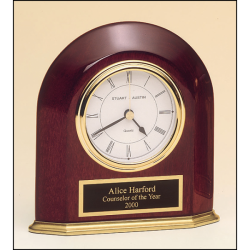 Rosewood stained piano finish arched table clock with solid brass base and three hand movement