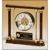 Traditional glass and rosewood piano-finish clockwith gold metal accents