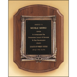 Solid American walnut plaque with an antique bronze casting.