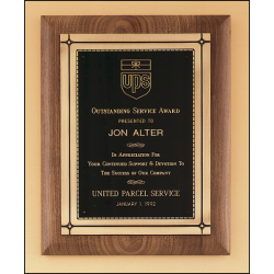 Solid American walnut plaque with an antique bronze Phoenix frame casting.