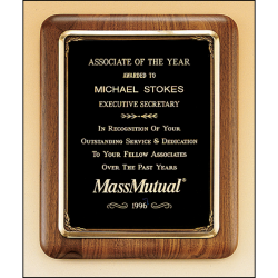 Solid American walnut plaque with an antique bronze plated metal frame casting