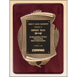 Rosewood stained piano finish plaque with an antique bronze finished frame casting