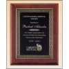 Rosewood stained piano finish plaque with an antique bronze finished frame casting and black brass engraving plate