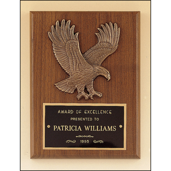 American walnut plaque with a sculptured relief eagle casting