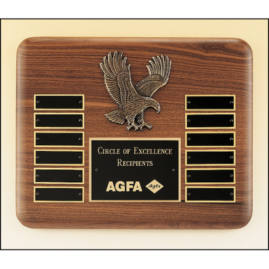 American walnut perpetual plaque with 12 black brass plates and a sculptured relief eagle casting