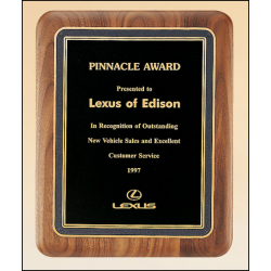 Solid American walnut plaque with a black florentine border and black textured center.