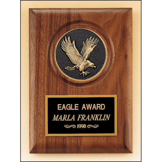 American walnut plaque with a finely detailed black and gold eagle medallion